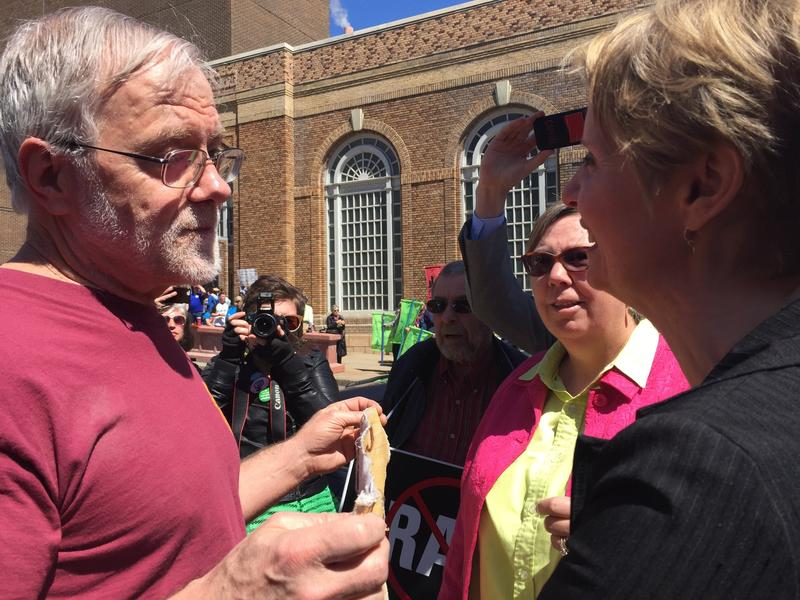 Gubernatorial candidates Howie Hawkins, left, and Cynthia Nixon meet at a climate rally in Albany Monday