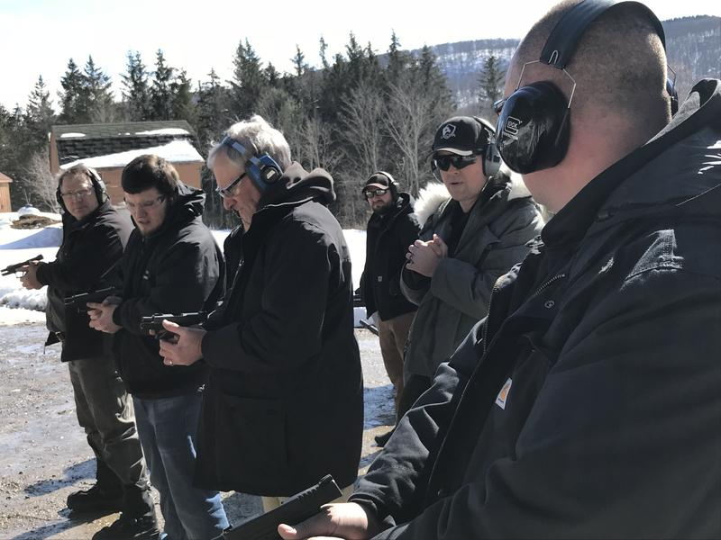 Army veteran and owner of a firearms training company Matt Mallory, second from right, is offering his classes free for teachers and school personnel as a way to prepare them for potential mass shootings.