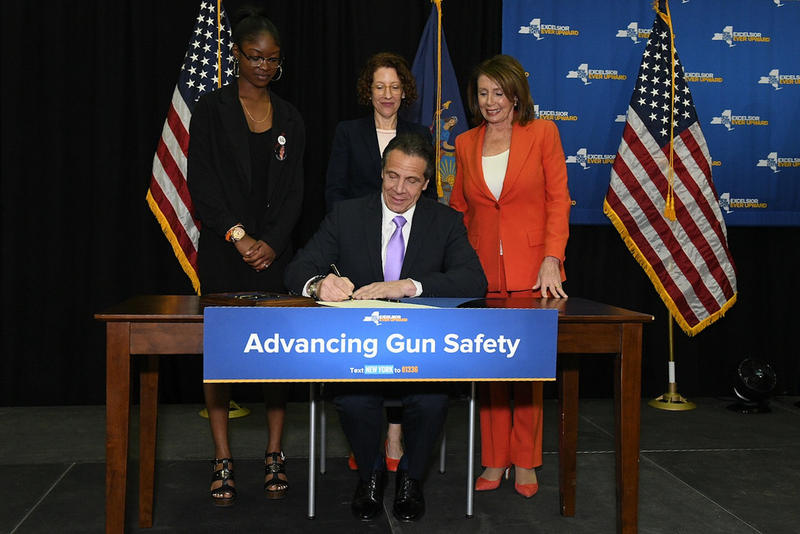 Gov. Andrew Cuomo signs a bill Tuesday that would take guns away from people accused of domestic violence