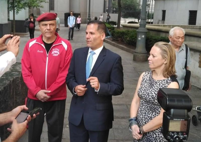 Republican gubernatorial candidate Marc Molinaro, center, speaks outside the federal courthouse in Manhattan Monday