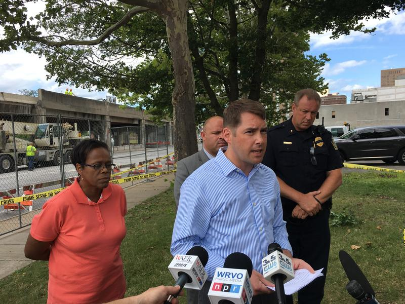 Syracuse Mayor Ben Walsh address reporters in front of the site of the sidewall collapse.