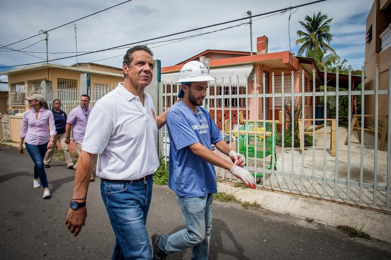 Gov. Andrew Cuomo walks with a student volunteer while in Puerto Rico Monday