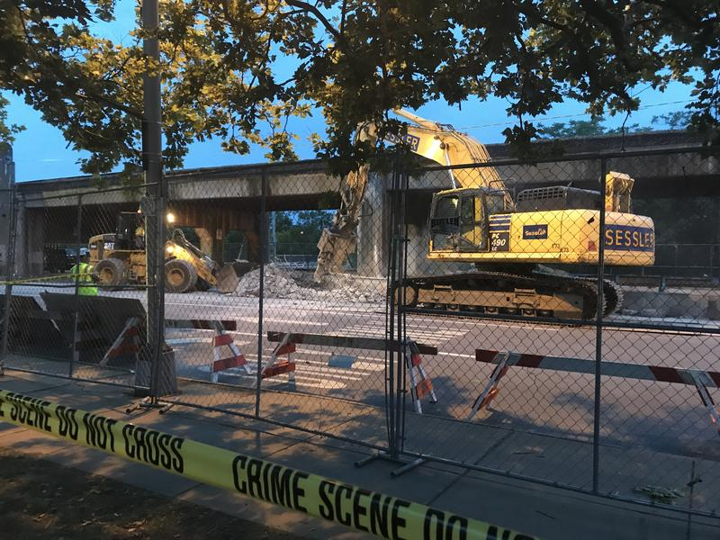 A portion of Clinton St. in Syracuse remains closed while crews try to repair a section of railroad bridge that collapsed Thursday