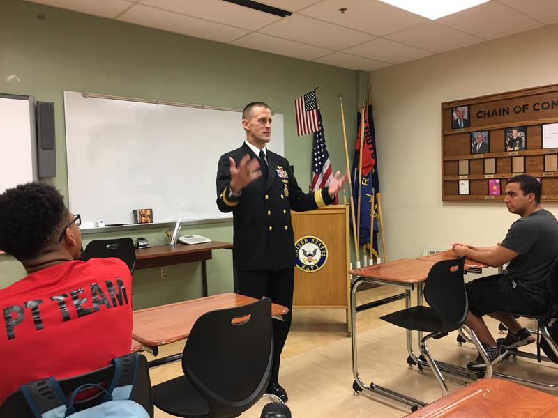 U.S. Navy Rear Admiral John Okon speaks with students at the Public Service Leadership Academy at Fowler High School in Syracuse.