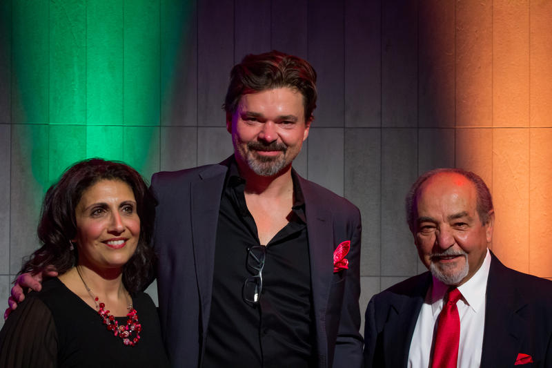 Hunter Foster (center) stands with Redhouse Executive Director Samara Hannah and Board President Bill Hider.