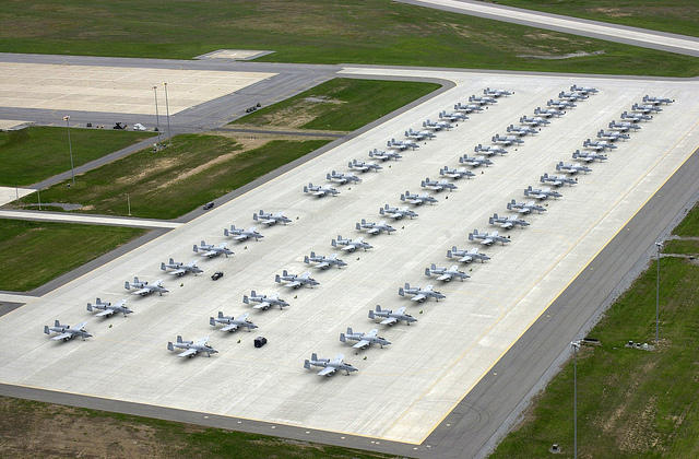 High angle view of the ramp at Wheeler Sack Army Airfield, Fort Drum, New York (NY), during the Hawgsmoke 2002 Competition, showing US Air Force (USAF) Air National Guard (ANG), maintenance personnel preparing A-10 Thunderbolt II aircraft for competition.