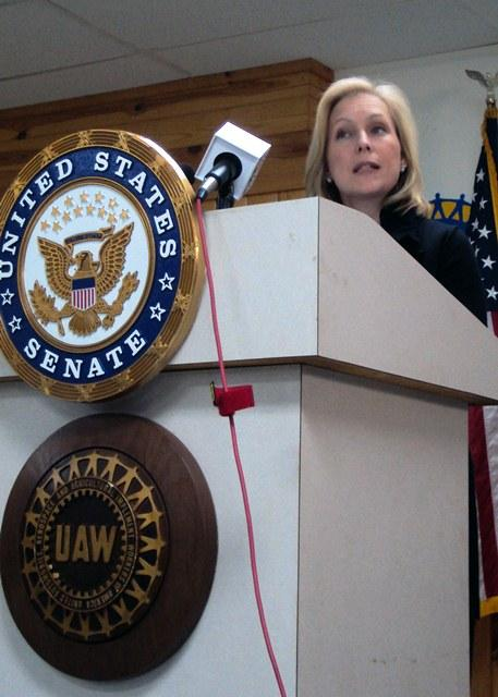 Sen. Kirsten Gillibrand stopped by a United Auto Workers union hall in Syracuse Monday to trumpet support for new tariffs.