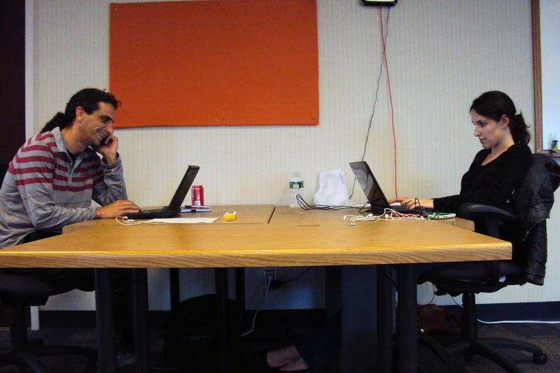 Amir Cohen, left, works with business partner Hagar Romach at the StartFast Accelerator in Syracuse.