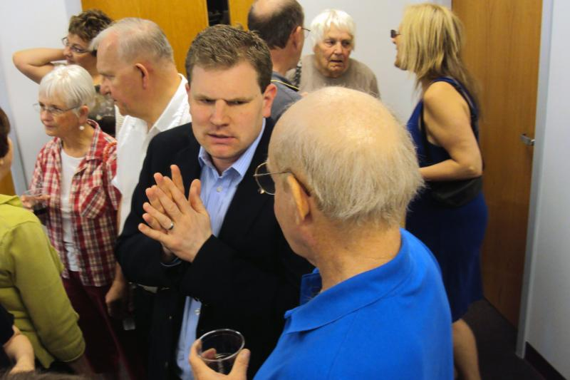Dan Maffei, center, talks with supporters Saturday as he opened his campaign headquarters in Syracuse.