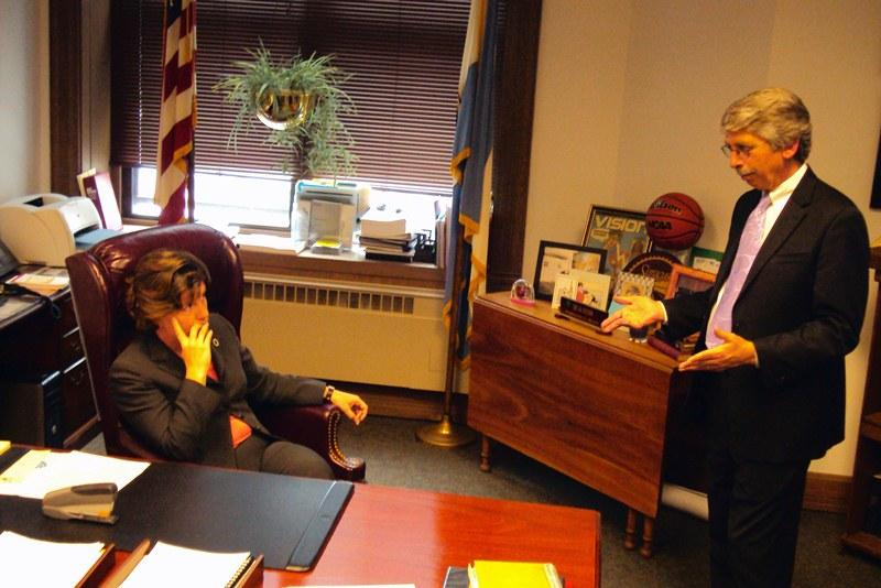 Syracuse Mayor Stephanie Miner, left, talks with reporter Bill Carey following the Common Council's approval of the budget Monday.