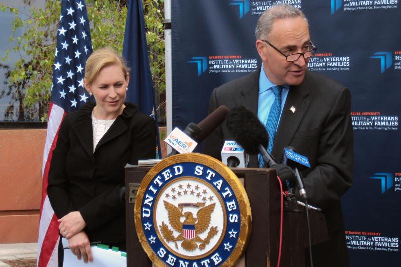 Sen. Charles Schumer (D-NY) addresses the media and veterans during a press conference Monday with Sen. Kirsten Gillibrand (D-NY) beside him.