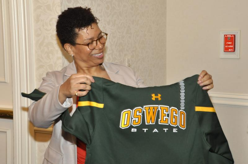 Michel Martin receives her new Oswego sweatshirt