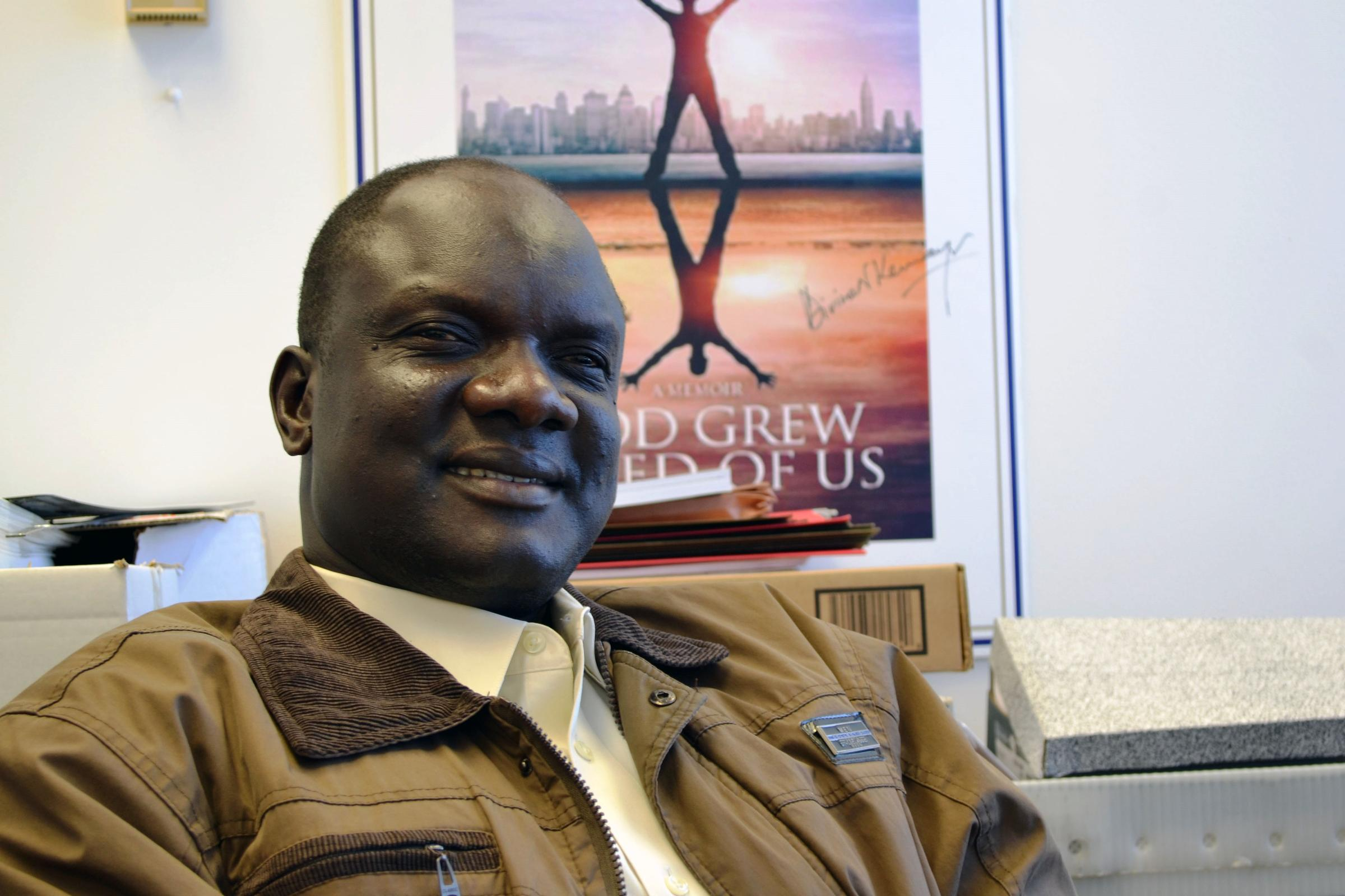 Senseless war threatens former lost boys work in south sudan john dau a former lost boy sudanese refugee in his office in syracuse publicscrutiny Gallery