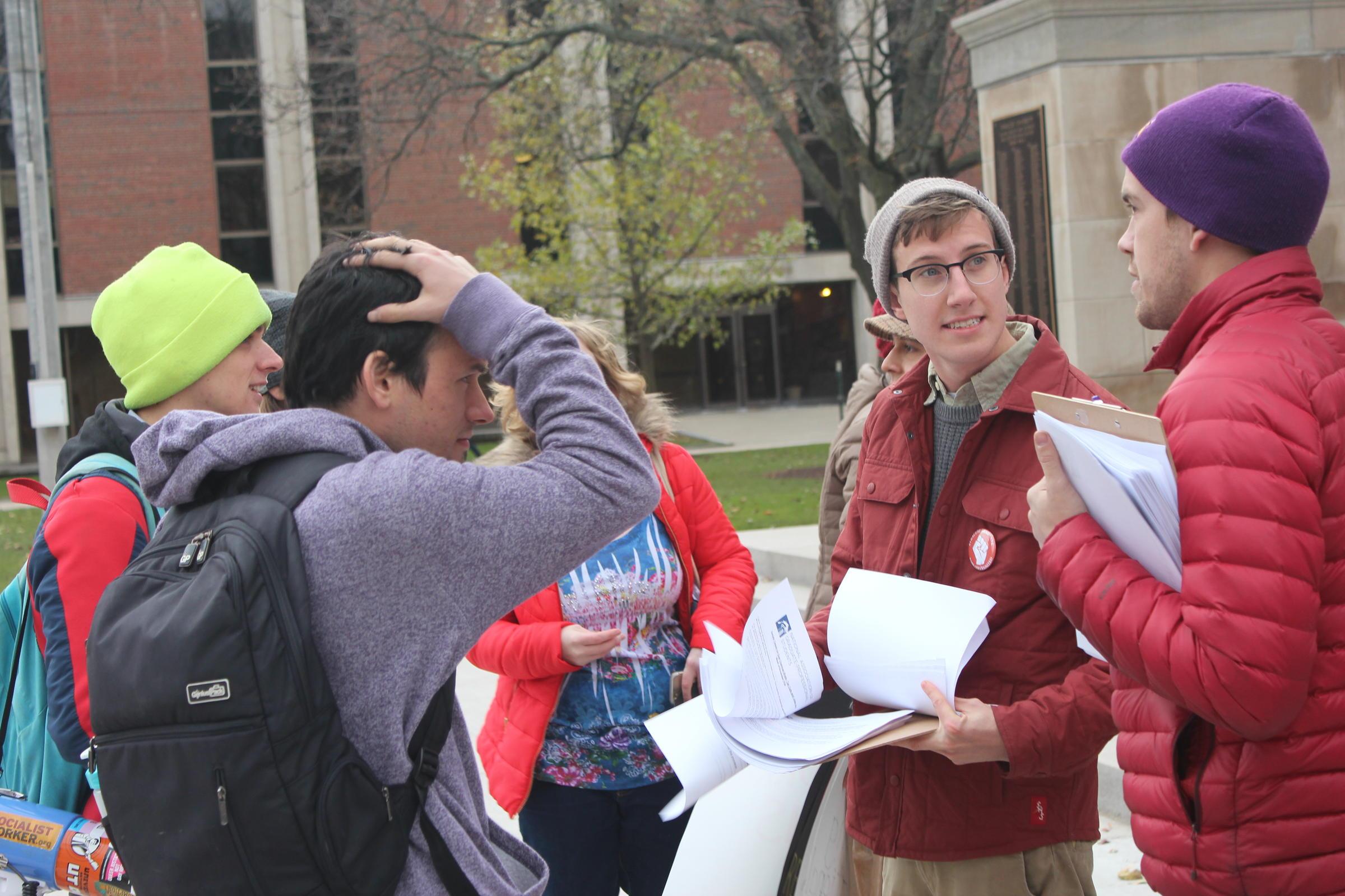 Brandon Daniels talks with other SU students