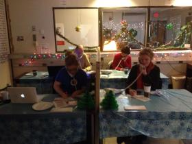 Volunteers answering phones for our recent one day, end of year Holiday Drive!