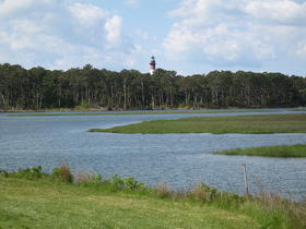 Chincoteague National Wildlife Refuge on Assateague Island, Virginia showing the Assateague Channel with the Assateague Light in the distance. Photograph taken in May 2008 from Maddox Boulevard facing south, showing the north side of the island.