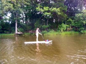 DPR staff member tries out paddleboarding