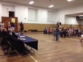 Newtown resident Yolie Moreno speaking at the meeting