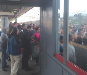 Commuters wait on a crowded platform at the Stamford, Conn. train station