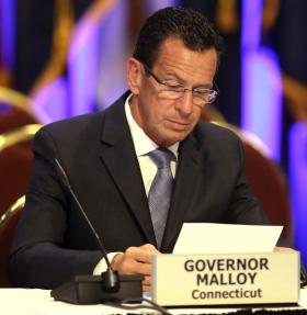 Connecticut Gov. Dannel Malloy looks over some note during a session of the National Governors Association meeting Sunday, August, 4, 2013 in Milwaukee.
