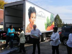 Bridgeport Mayor Bill Finch (center) helps deliver Connecticut Food Bank donations to Head Start program at Action for Bridgeport Community Development