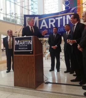Candidate David Martin gestured to Governor Dannel Malloy, as William Tong looks on.
