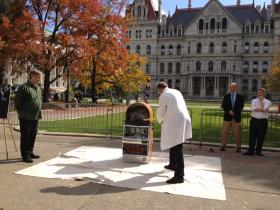 Dr Stephen Shafer, with the Coalition Against Gambling, takes his turn w/ the sledgehammer