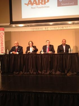 Stamford mayoral candidates in the GenRe auditorium at the UConn-Stamford campus on Thursday.