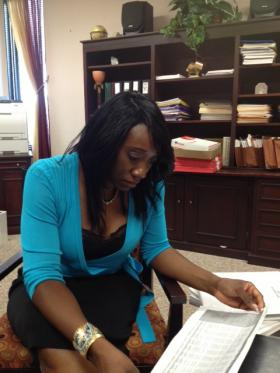 NEON Acting CEO Chiquita Stephenson reviews a financial report in her office at the agency's Norwalk, Conn. headquarters.