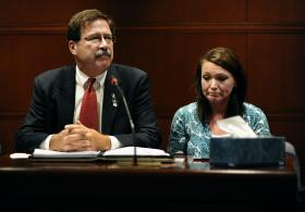 Bill Sherlach (left), husband of Sandy Hook Elementary School shooting victim Mary Sherlach, and Nicole Hockley (right), mother of victim Dylan Hockley, speak before the Connecticut Freedom of Information Commission, Wednesday, Oct. 30, 2013, in Hartford, Conn.