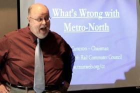 Jim Cameron, who announced he's retiring from the Connecticut Metro-North Rail Commuter Council, speaking to the Westport Rotary Club