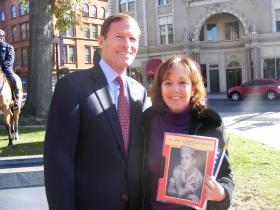 Sen. Richard Blumenthal with Lisa Waldo, daughter of the late Joseph DelGrande, a World War II veteran from Bridgeport, who's lost medals were presented to the family by Blumenthal.