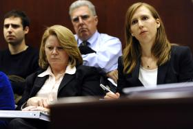 UConn Police Chief Barbara O'Connor, left, and Elizabeth Conklin, UConn's Title IX coordinator, right, listen to testimony from four women who say they were victims of sexual assaults while students at UConn at the Legislative Office Building, Wednesday, Nov. 13, 2013, in Hartford, Conn. The four women have filed a federal discrimination lawsuit against the school.