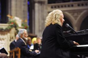 Singer Carole King performing at a vigil for victims of the shooting at Sandy Hook Elementary School in Newtown, Conn. and other victims of gun violence, Thursday, Dec. 12, 2013, at the National Vigil for Victims of Gun Violence at the National Cathedral in Washington. The one year anniversary of the Newtown, Conn. shootings is December 14.