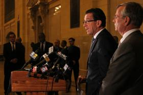 James Redeker, Connecticut Transportation Commissioner, right, stands by as Governor Dannel Malloy, second from right, speaks about a Metro-North service disruption at a press conference at Grand Central Terminal in this September 26th file photo.