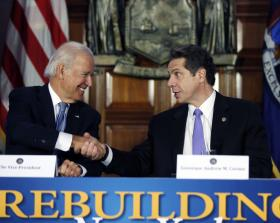 Vice President Joe Biden, left, shakes hands with New York Gov. Andrew Cuomo after a discussion on the state's rebuilding efforts following Superstorm Sandy, Tuesday, Jan. 7, 2014, in the Red Room at the Capitol in Albany, N.Y.
