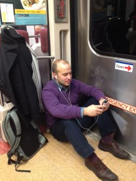 Eric Garcia sits on a Metro-North train on his way home from New York City to New Canaan. He says his 55-minute commute has increased by 15 minutes and there are often no seats.