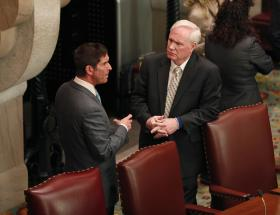 Independent Democratic Conference leader Jeffrey Klein, left, D-Yonkers, and Sen. Tony Avella, D-Queens, talk in the Senate Chamber at the Capitol on Wednesday, Feb. 26, 2014, in Albany, N.Y. Avella will become the fifth member of the IDC, which has ruled the state Senate in a coalition with Republicans since 2011.