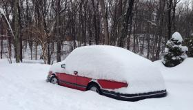 Snow covering a parked car in Stamford, Connecticut. Fairfield County saw some of the largest snowfall amounts in the region, with over a foot of snow reported in some areas.