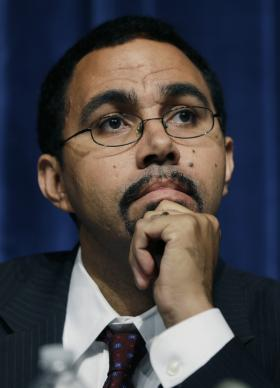 State Education Commissioner John King, Jr., listens to a speaker during a forum on Common Core learning reforms.