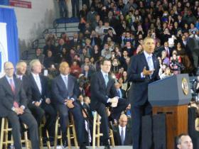 President Obama speaking at the minimum wage rally at Central Connecticut State University in New Britain on Wednesday March 5th, 2014. Seated on stools from left to right behind Obama are US Labor Secretary Tom Perez, Vermont Gov. Peter Shumlin, Rhode Island Gov. Lincoln Schafee, Massachusetts Gov. Duval Patrick and Connecticut Gov. Dannel Malloy.