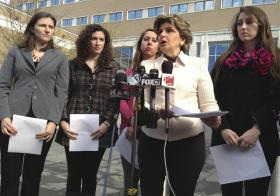 Attorney Gloria Allred, second from right, speaks to the media on Friday, Nov. 1, 2013 outside of U.S. District Court in Hartford, Conn. Allred filed a federal lawsuit on behalf of the four women with her, from left, Kylie Angell, Rosemary Richi, Erica Daniels and Carolyn Luby, who claim the University of Connecticut violated their civil rights in response to sexual assault allegations the women made while students at the school