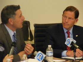 US Senator Richard Blumenthal of Conn. (right) listening to Michael Botticelli, the acting director of the Office of National Drug Control Policy, at the heroin addiction forum at the Cornell Scott-Hill Health Center in New Haven on Thursday April 17, 2014.