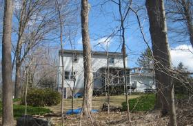 Gene De Joannis' tree-surrounded house in Manchester, Conn.
