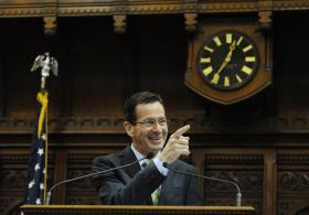 Connecticut Gov. Dannel P. Malloy addresses the House and the Senate at the end of session at the Capitol on the final day of session, Thursday, May 8, 2014, in Hartford, Conn.