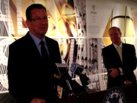 Gov. Dannel Malloy at the Stamford headquarters of Starwood Hotels and Resorts on Thursday, as Ken Siegel of Starwood looks on.