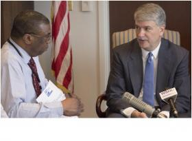 State Senator Donald Williams (right) speaking in his office in Hartford with WSHU's Ebong Udoma