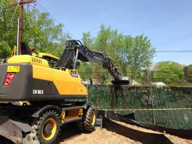 A front loader took down a section of the New Haven-Hamden fence on Monday