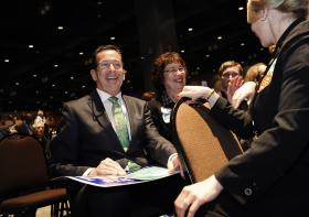 Gov. Dannel Malloy, left, sits with Middletown, Conn. delegates Domenique Thornton, center, and Mary Bartolotta, right, after accepting the Democratic nomination for governor at the Connecticut Democratic Convention, Friday, May 16, 2014, in Hartford, Conn.