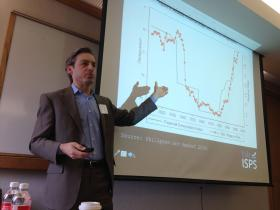 Yale political scientist Jacob Hacker, speaking at a conference on inequality. The chart he points to depicts a correlation between wages in the financial industry, and financial deregulation
